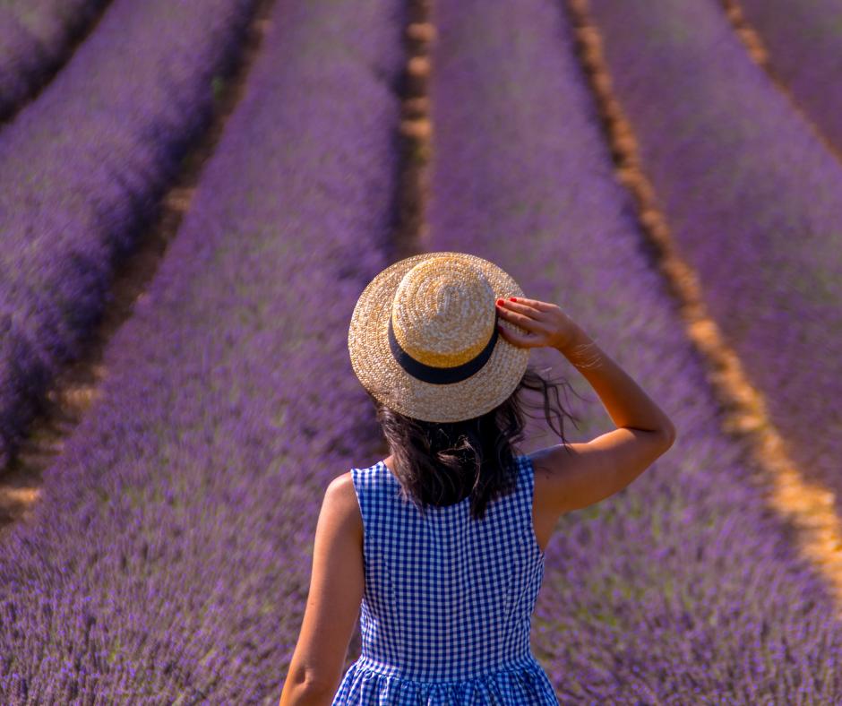 Woman walking through a field of flowers